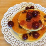 Cornmeal Chocolate Chip Pancakes with Brandied Cherries
