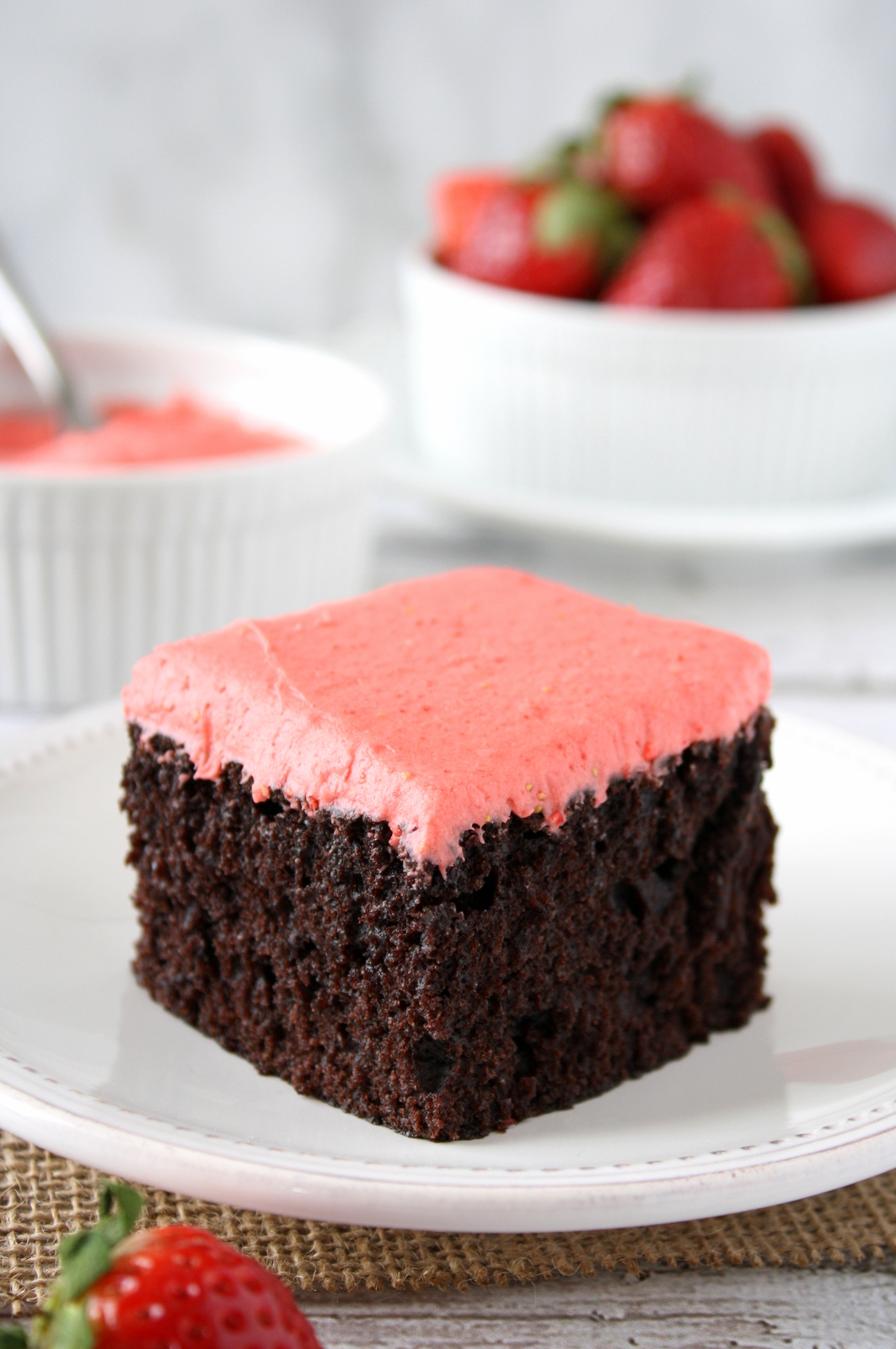 chocolate snack cake with strawberry frosting